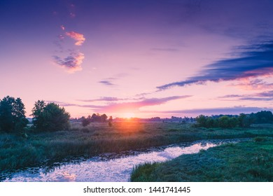 Magical sunset in countryside. Rural landscape in evening. Aerial view