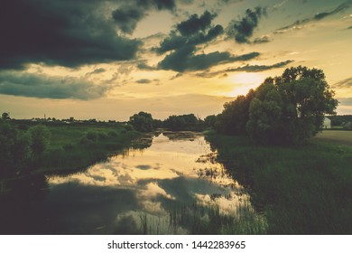Magical sunset in countryside. Rural landscape in evening. Aerial view of river