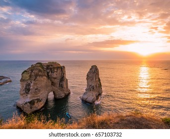 Magical sunset on Raouche, Pigeons' Rock. In Beirut, Lebanon