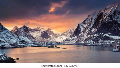 magical sunset over the mountains and the sea of Lofoten islands in Norway
