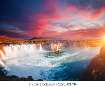 Magical sunset of powerful Godafoss cascade. Location place Bardardalur valley, Skjalfandafljot river, Iceland, Europe. Scenic image of most popular tourist attraction. Discover the beauty of earth.