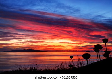 Magical sunset. Sky red painting. Syros island, Greece