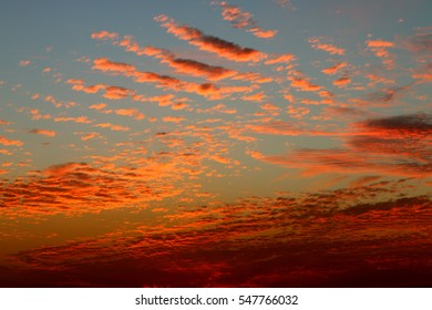 Magical sunset in winter, cloudy sky, sun ray in the sea of clouds