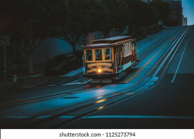 Magical twilight view of historic Cable Car riding on famous California Street at dawn before sunrise, San Francisco, California, USA