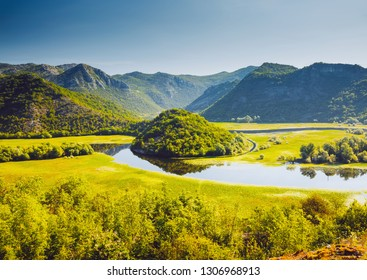 The magical valley of the Rijeka Crnojevica on a sunny day. Location place National park Skadar Lake, Montenegro, Balkans, Europe. Scenic image of the exotic summer scene. Explore the beauty of earth.