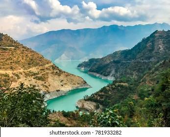 Magical views of landscape of Bhagirathi River near Tehri Dam in Chamba in Uttarakhand, India. Tehri Dam is the highest dam in India. Green mountains of Chamba in Uttarakhand is just mystical to eyes.