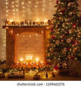 Magical warm Christmas setting, decorated fireplace with solid wood mantelpiece, lit up Christmas tree with baubles and ornaments, stars, Christmas lights, candles, selective focus