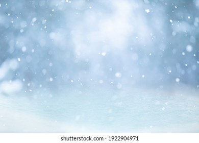 MAGICAL WINTER BACKGROUND WITH SNOW, SNOW FLAKES AND SOFT BOKEH LIGHTS ON BLUE SKY, COLD BACKDROP FOR CHRISTMAS, SNOWY STILL LIEFE AT FROSTY WEATHER TIME