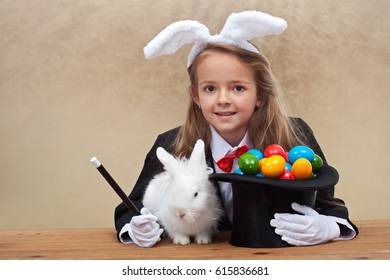 Magician girl bringing easter - conjuring up a white bunny and colorful eggs, on golden background