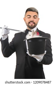 Magician holding hat with rabbit on white background