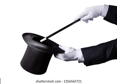 Magician holding a top hat and a wand isolated on white