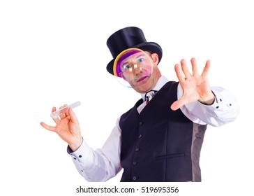 magician looks through soap bubble
