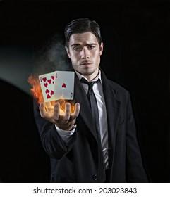 Magician producing black jack