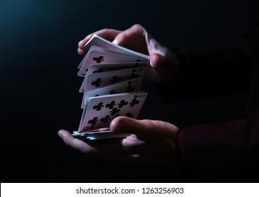 magicians hands shuffling cards