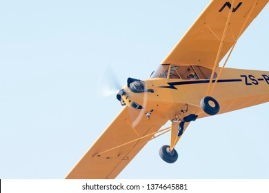 MAGLIESBURG, SOUTH AFRICA-JUNE 23 2018: A close up of a yellow Piper Cub during the trains, planes and automobile event between Krugersdorp and Magaliesburg