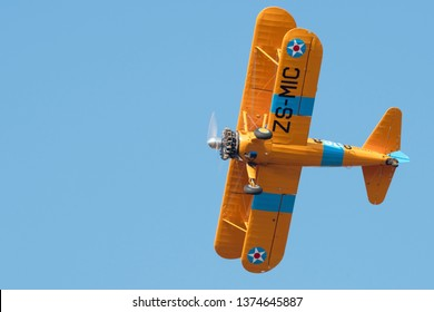 MAGLIESBURG, SOUTH AFRICA-JUNE 23 2018: A yellow Boeing Stearman banking away during the trains, planes and automobile event between Krugersdorp and Magaliesburg