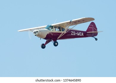 MAGLIESBURG, SOUTH AFRICA-JUNE 23 2018: A red and cream Piper Cub approaching during the trains, planes and automobile event between Krugersdorp and Magaliesburg