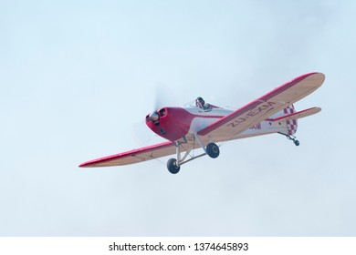 MAGLIESBURG, SOUTH AFRICA-JUNE 23 2018: A red and white Bowers Fly Baby flying overhead during the trains, planes and automobile event between Krugersdorp and Magaliesburg