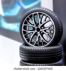 Magnesium alloy car wheel rims display in automotive store. Car Accessories.