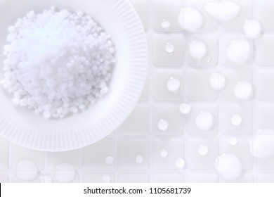 Magnesium Bath Crystals and water drops on white tile