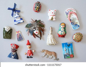 Magnet collection. Souvenir fridge magnetic collection from all around the world. Japanese text on the red lantern meaning god of thunder.