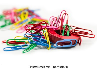 Magnet covered by paper clips isolated on a white background