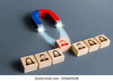 The magnet pulls a red person figure out of the row. Luring concept. Hiring best candidate. Poaching participants from other company. Selection for a management position on a competitive basis.