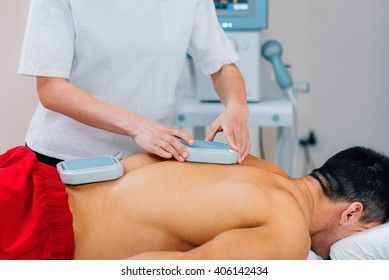 Magnet therapy - Physical therapist placing magnets for treatment of patient's back