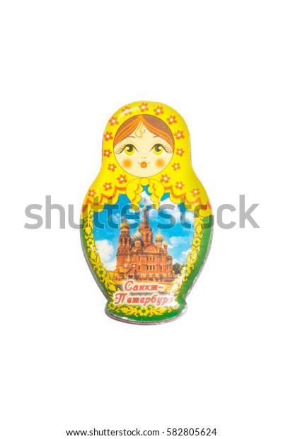 Magnetic babushka souvenir, isolated on white.