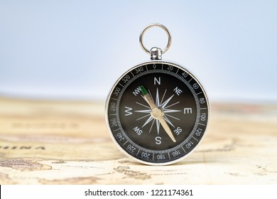 Magnetic compass on vintage map for travel and tourism, vacation or wanderlust life concept, plan for next destination, new adventure journey.