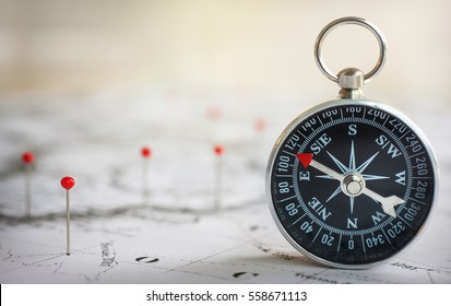 Magnetic compass on a world map conceptual of global travel , to