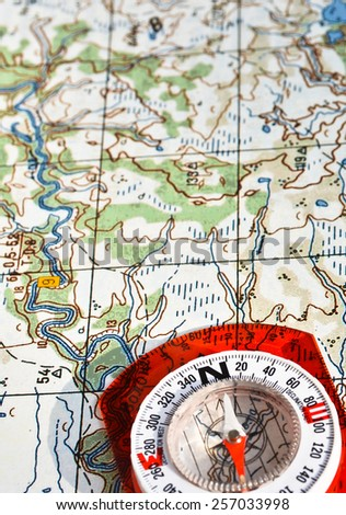 Topographic Map Games.Magnetic Compass Topographic Map Travel Compass Stock Photo Edit