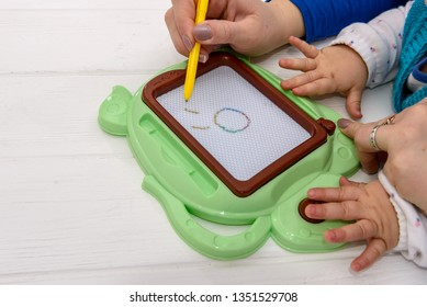 Magnetic drawing board for preschool education .
