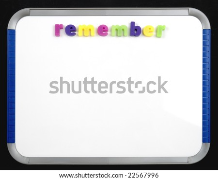 a magnetic letter board with the word remember