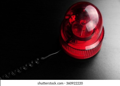 Magnetic Mounted Red Vehicle Police Strobe Rotating Flash Warning Light Beacon Flashing Emergency Lights On Black Background, Top View