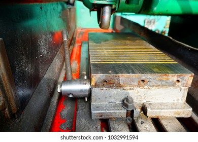 Magnetic plate on the grinding machine. Electric magnetic sine table.