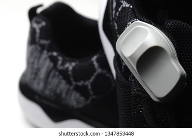 Magnetic shoe tag. Security technology. Chipping shoes.