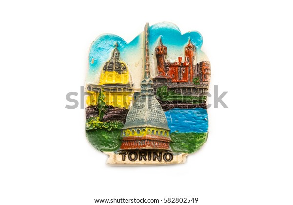Magnetic souvenir from Turin, Italy, isolated on white.