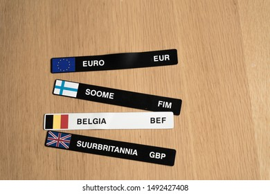 Magnetic stripes with EUR, Finnish markka  FIM, Belgian franc BEF and British pound GBP symbols. (Translation: Finland, Belgium, Great Britain). National flags on labels.
