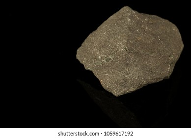 Magnetite, iron ore mineral, iron oxide, magnetic, lodestone, isometric hexoctohedral crystal structure isolated on black background. Rocks and minerals