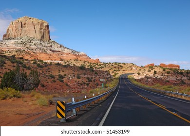 Magnificent American highway in stone desert. State of Utah, early morning