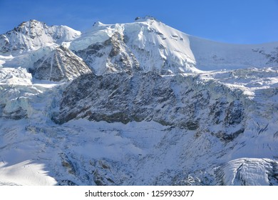 Magnificent assembly of peaks. Left to Right : Pointes du Moming (North and South) and Zinalrothorn in the Val d'Anniviers in the Southern Swiss Alps