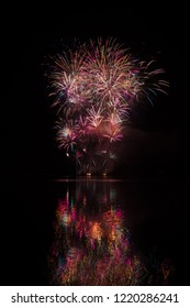 Magnificent, big and rich fireworks over Brno's Dam with lake reflection