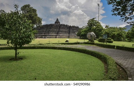 Magnificent Borobudur Temple and green garden foreground during summer