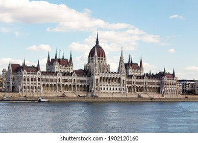 The magnificent building of the Hungarian Parliament on the Danube River embankment. Summer sunny day. Budapest, Hungary.