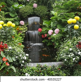 Magnificent cascade fountain and goldenfish in  Butchard-garden on island Vancouver