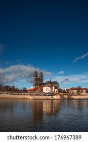 Magnificent Cathedral of Magdeburg at river Elbe with blue sky, Germany, 2014