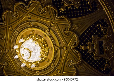magnificent chandelier on the ceiling with a stucco molding