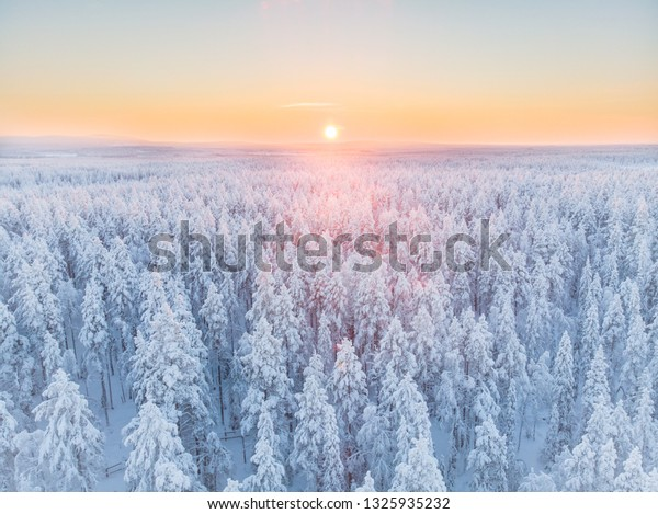 Magnificent colorful sunrise in the winter landscape of Lapland, Finland