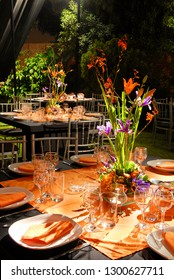 Magnificent garden wedding celebration with orange and black thematic and impressive floral displays.